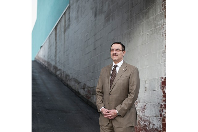 Embattled but resilient Mayor Vince Gray stands outside a charter school in Northeast Washington. - (Charles Ommanney for CNN)