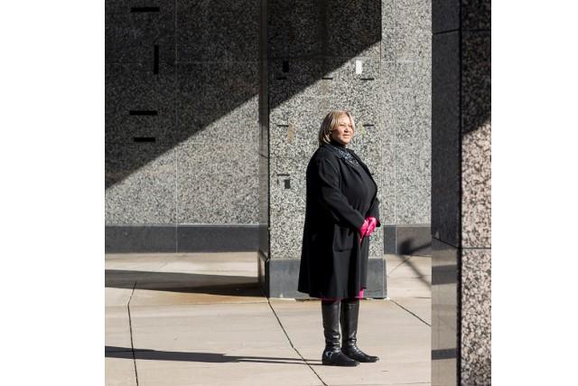 Council Member Yvette Alexander walks outside of the deteriorating Robert F. Kennedy Stadium. - (Charles Ommanney for CNN)