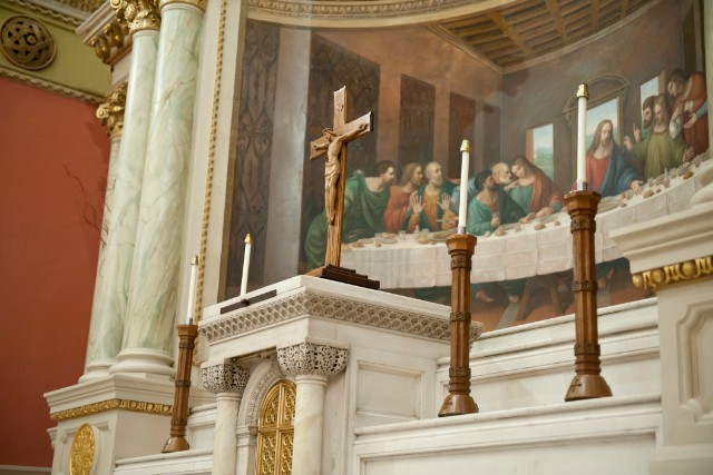 Behind the altar at St. Cecilia Parish is a tableau of the Last Supper. - (Webb Chappell for CNN)