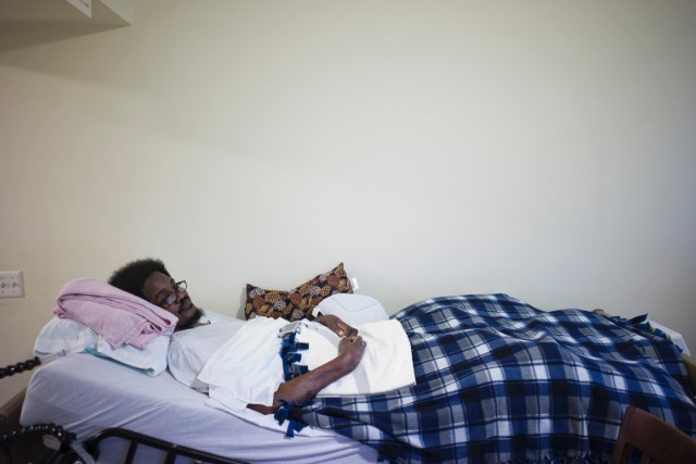 Harris, 48, is bedridden with ALS and lives with his mother who cares for him. - (Carlos Javier Ortiz for CNN)