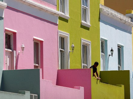 The colorful Bo Kaap district of Cape Town features vibrant houses like these.