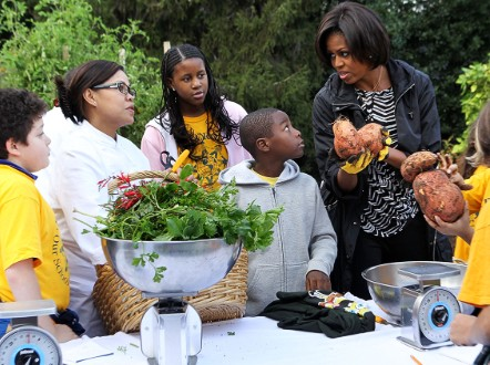 Youngsters weigh into the South Lawn harvesting with Chef Comerford and the First Lady. - (Getty Images)