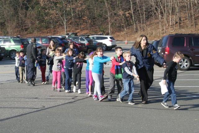 Police evacuate children from Sandy Hook Elementary School in Newton in 2012.