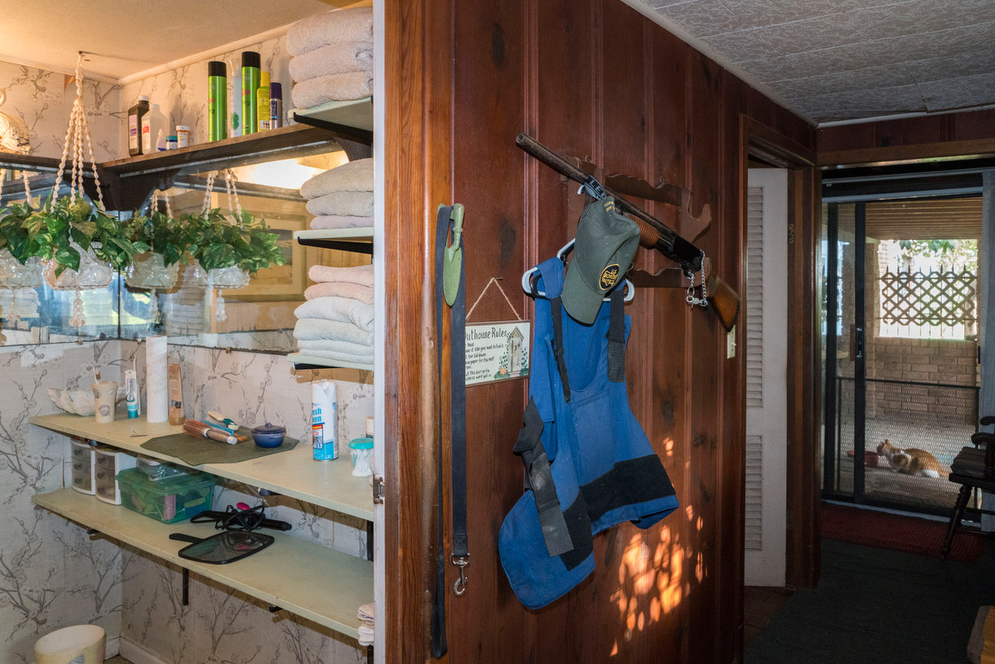 A Border Patrol vest and rifle hang from a hook in the home of Pamela Taylor, an 88-year-old English-American woman who married a Mexican-American man from Brownsville she met during World War II and moved to the US shortly afterwards.