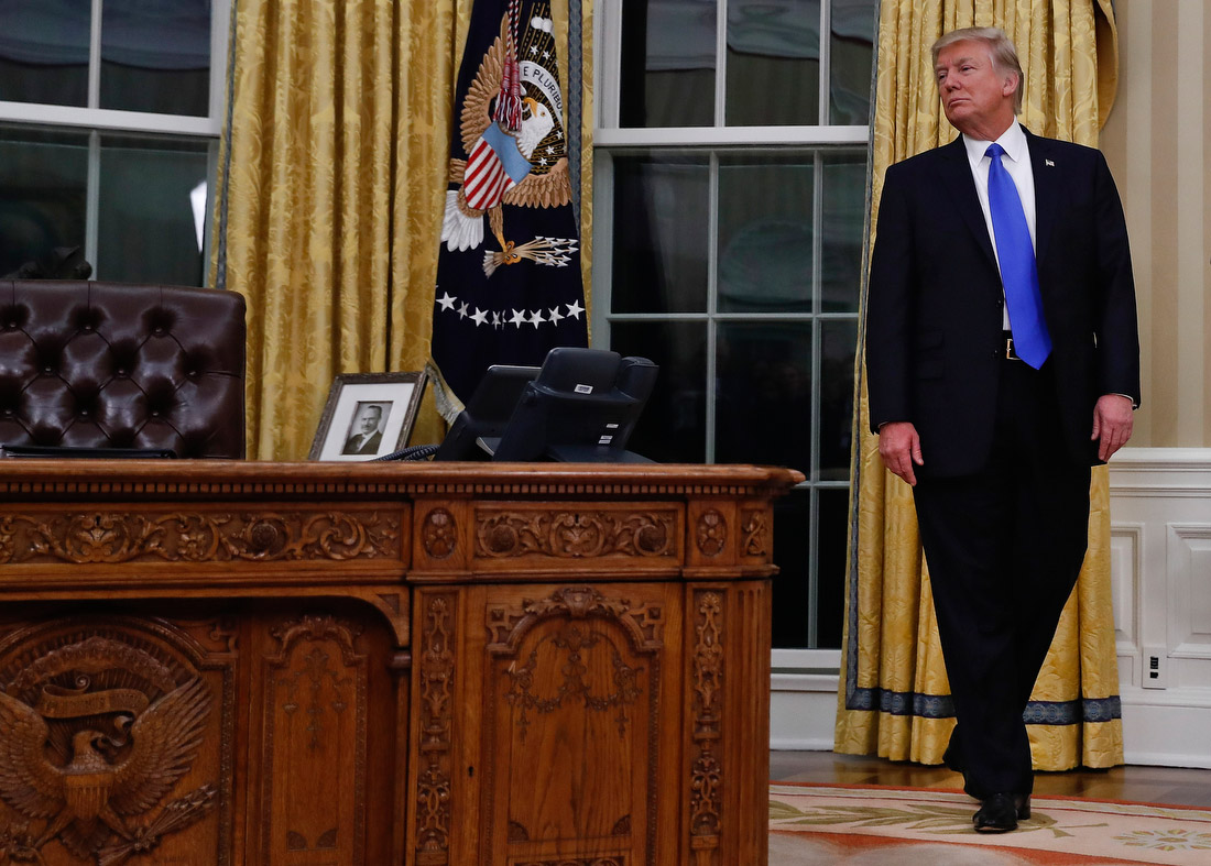 oval office resolute desk. Trump Pauses Near The Resolute Desk In White House Oval Office On Wednesday, February 1. It Was During Swearing-in Ceremony Of Secretary State O