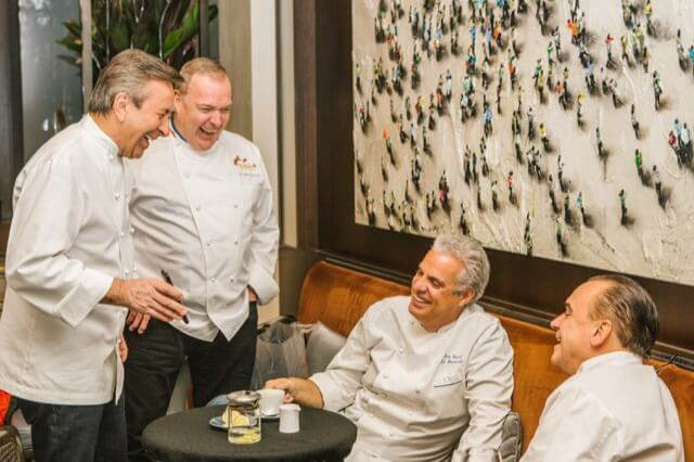 The four renowned chefs share laughs over tea. (Daniel Boulud, Jacques Torres, Eric Ripert and Jean-Georges Vongerichten.)