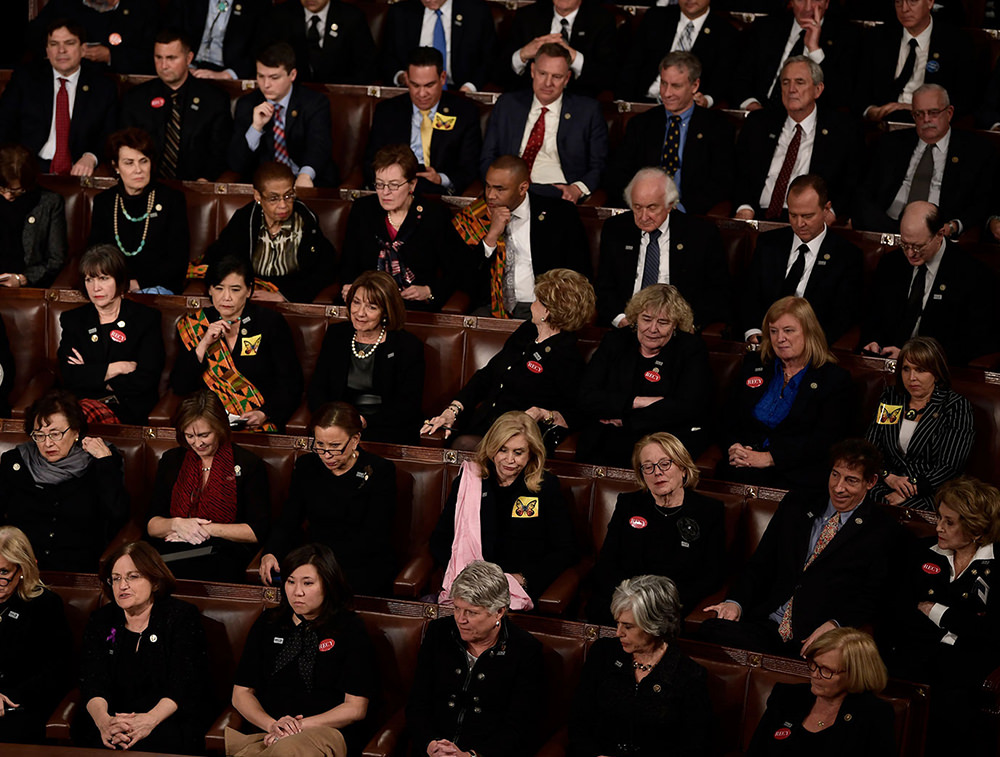 200 Congresswomen and men wear black and Time's Up pins