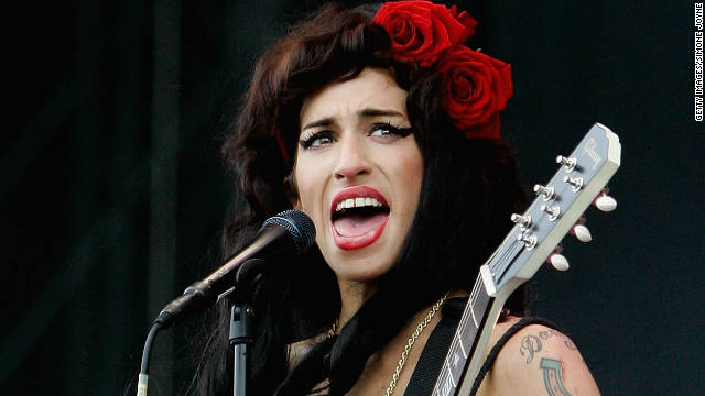 """Rehab"" and ""Valerie"" singer Amy Winehouse was found dead at her home in July; an inquest ruled she died of alcohol poisoning"