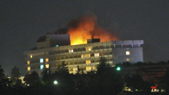 Flames light up the sky after the Kabul Intercontinental Hotel was attacked in 2011.