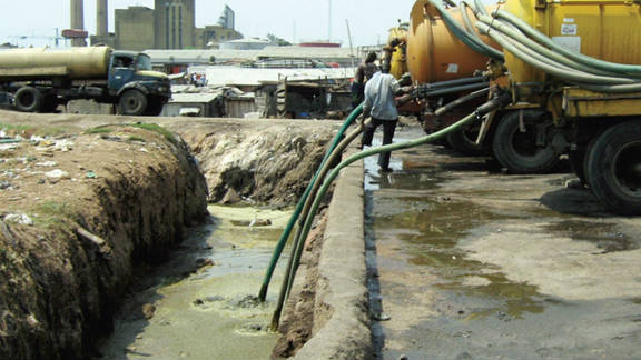 Sewage, collected from household septic tanks, is deposited in the Lagos lagoon