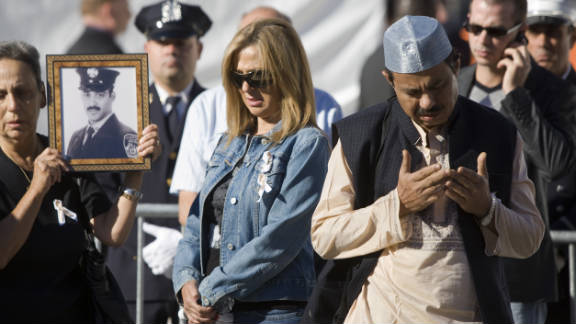 A Muslim  prays at the reflecting pool at ground zero as family members mark the 9/11 anniversary in 2010.