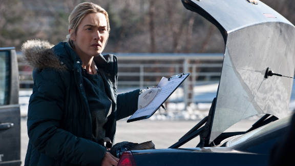 "Kate Winslet stars as a young detective in the virus-out-of-control movie  ""Contagion."""