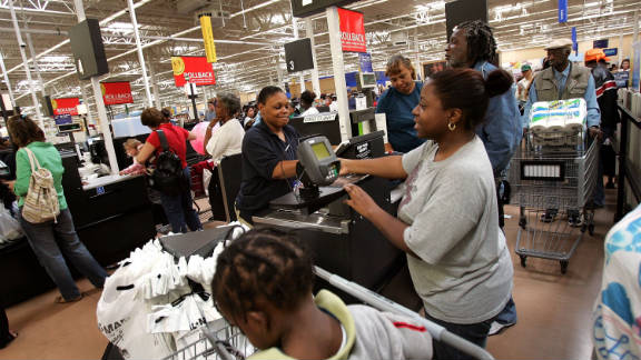 Cashiers work at a Walmart in Chicago.