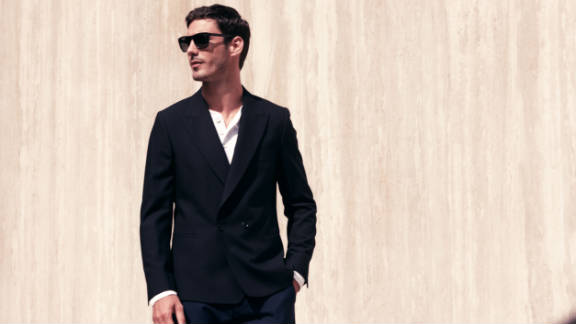 Another Park and Bond model wears sunglasses from Oliver Peoples, a henley shirt by Vince, jacket by Paul Smith and pants by Gant Rugger.