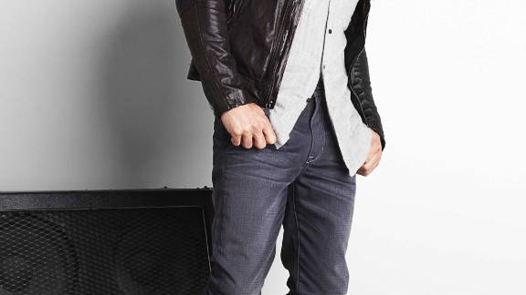 """CLAD's target audience is guys who want to dress well but aren't necessarily concerned about the latest trends off the runway, CEO Will Swillie said. Seen here, """"the concert"""" look: jacket by ROGUE, Joe's Jeans, sunglasses by John Varvatos Collection and boots by Billy Reid."""