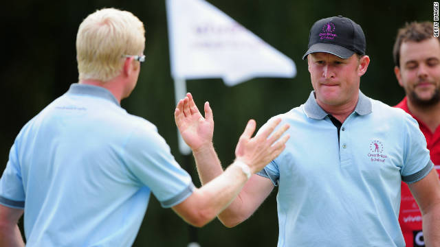 Jamie Donaldson, right, and Simon Dyson of the Great Britain & Ireland team celebrate during their victory on Thursday.