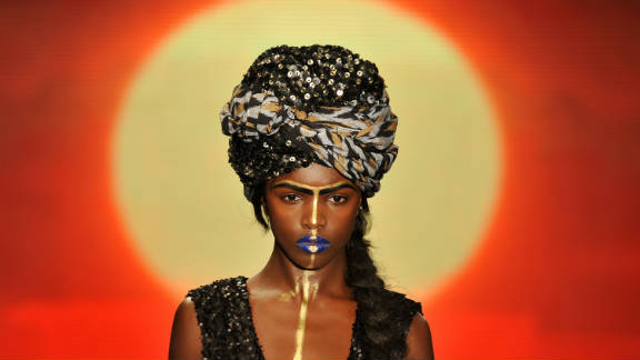 A model shows off an example of extravagant headwear from the House of Dereon collection.