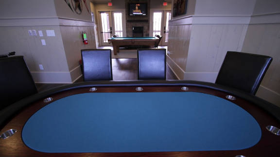 Among the resort-like amenities at The Retreat is a gameroom that features billiards, foosball and a poker table.