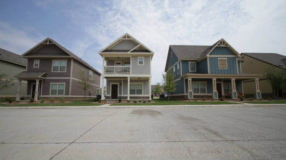 The housing units at The Retreat in Denton, Texas, are craftsman-style cottages.
