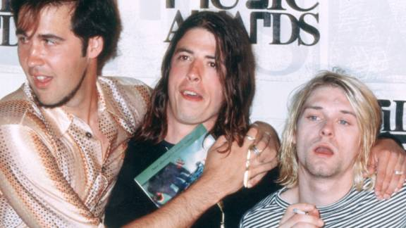 """In 1993, from left, Kris Novoselik, Dave Grohl and Kurt Cobain pose with Kevin Kerslake, who directed the video for """"In Bloom."""""""