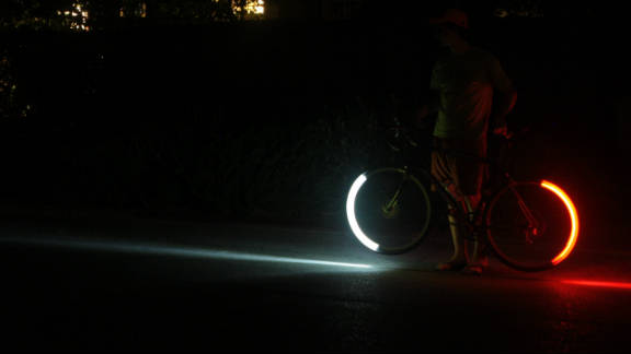 LED lights attached to wheel rims create a stunning glow of red and white light when the tires are in motion.
