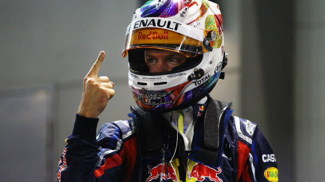 Red Bull driver Sebastian Vettel celebrates after finishing first during qualifying on Saturday.