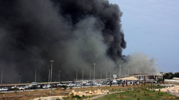 A  fuel storage warehouse burns at the port of the country's capital city Tripoli on Saturday.