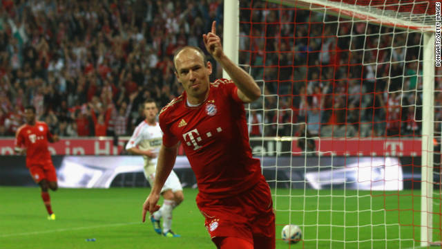 Arjen Robben celebrates scoring Bayern Munich's third goal against Bayer Leverkusen.