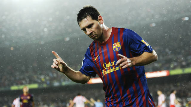 Lionel Messi celebrates after scoring his third goal during Barcaleona's 5-0 win over Atletico Madrid.
