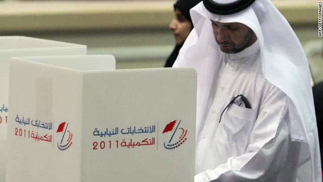 A Bahraini man votes at a polling station in the capital Manama on September 24.