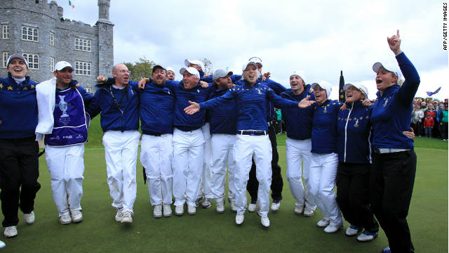 The winning European team celebrate their 15-13 win over the United States in the Solheim Cup