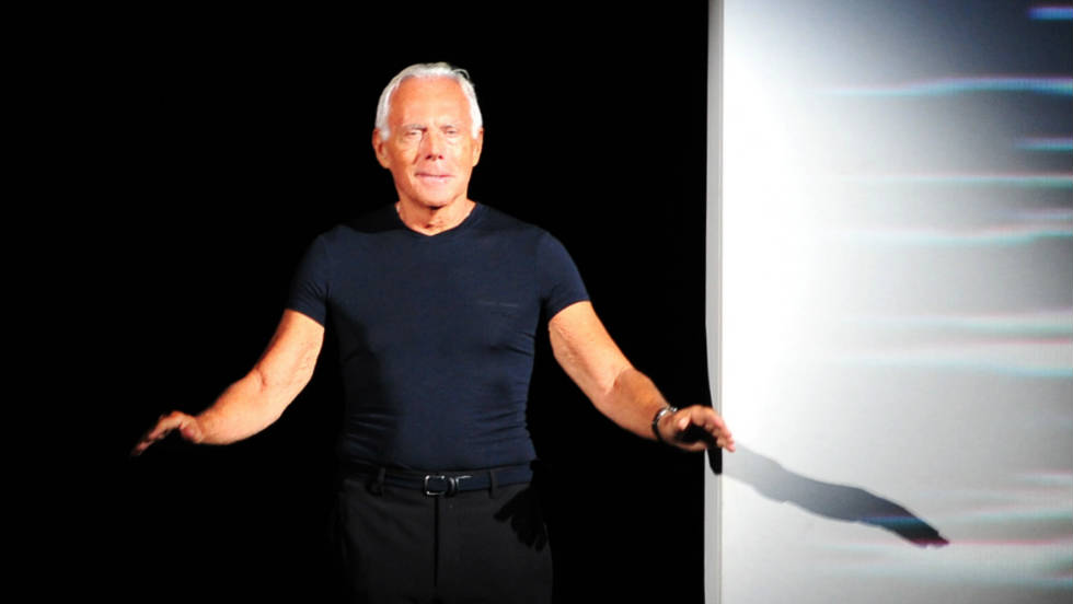 Italian designer Giorgio Armani acknowledges the audience at the end of his Spring-Summer 2012 ready-to-wear collection.
