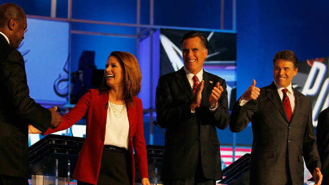 Candidates Herman Cain, from left, Michele Bachmann,  Mitt Romney, and Rick Perry chat before a CNN debate September 12.
