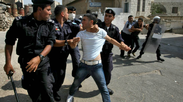 A Palestinian youth protests near the Jewish settlers zone of Abraham Avino in the West Bank city of Hebron on September 21.