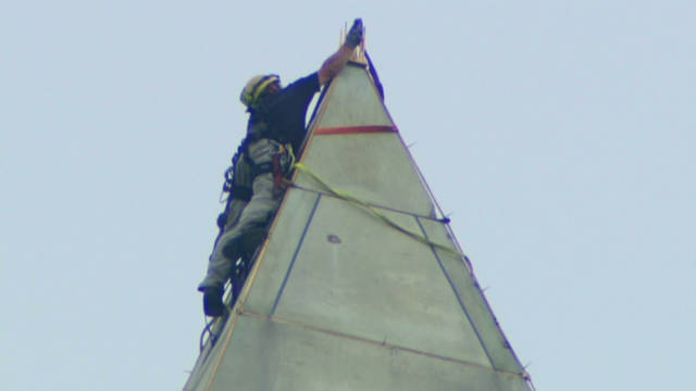 Crews rappel Monument to inspect damage
