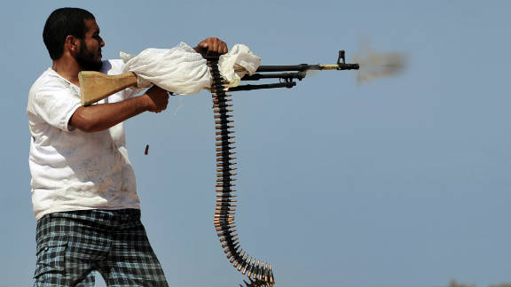 A National Transitional Council fighter practices firing his machine gun, 20 kilometers west of Sirte on September 26.