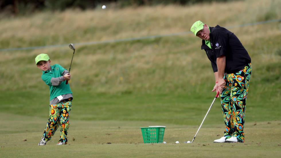 John Daly, winner of the 1995 Open Championship at St. Andrews, practises with his eight-year-old son, John Daly Jnr.
