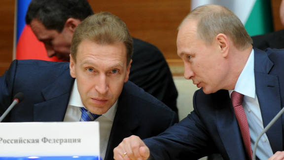 Vladimir Putin, right, speaks with Igor Shuvalov during a prime ministers from ex-Soviet states meeting in Minsk on May 19, 2011.