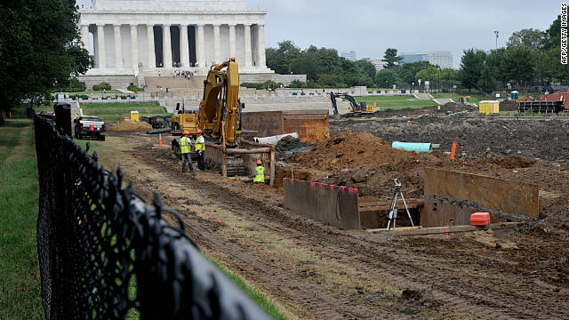 Crews work on rebuilding the famous Reflecting Pool on the National Mall in Washington.