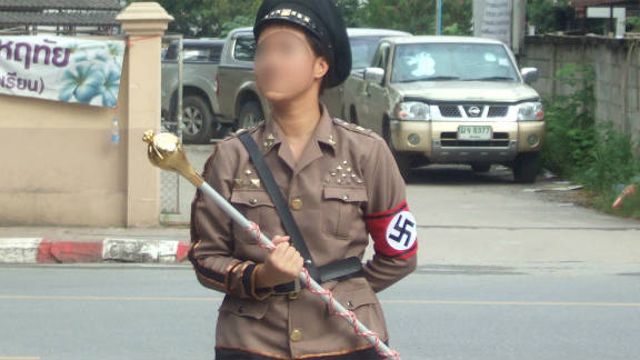Another student opted to dress up as Adolf Hitler for the parade to mark the school