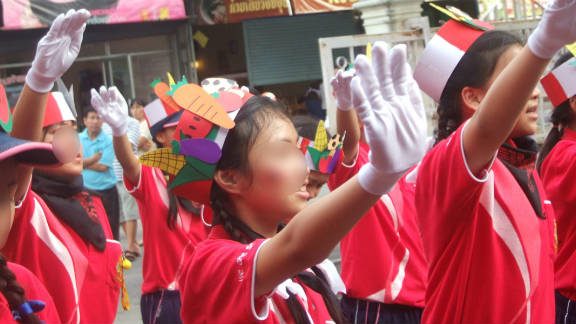 """Many of the children gave the infamous """"Sieg Heil"""" salute of the Nazis as crowds watched on."""