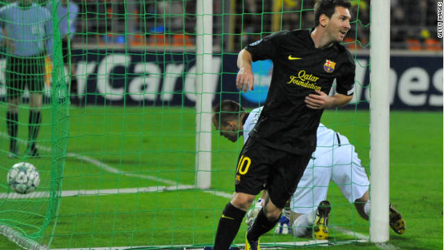 Lionel Messi celebrates the first of his two goals as Barcelona cruised to victory in Belarus