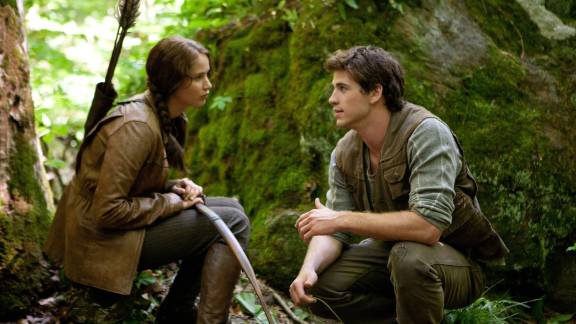 """The Hunger Games"" gives us a heroine named Katniss (Jennifer Lawrence) and her longtime pal Gale (Liam Hemsworth)."