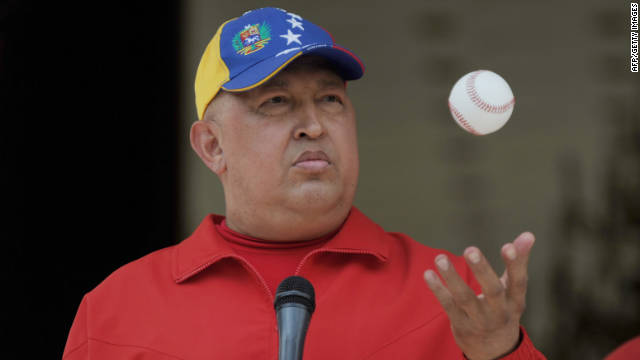 Venezuelan President Hugo Chavez tosses a baseball in the air during a press event at the presidential palace Miraflores.