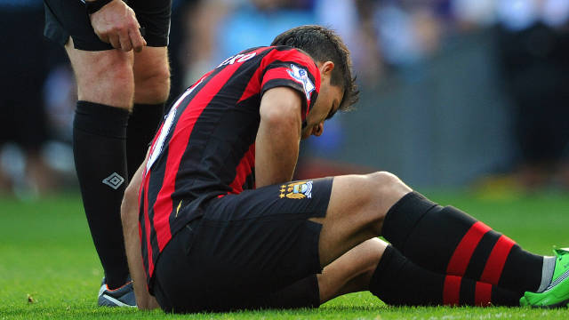 In-form striker Sergio Aguero sits injured during Manchester City's victory at Ewood Park.