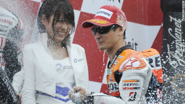 Dani Pedrosa celebrates his victory in the Japanese MotoGP in traditional style