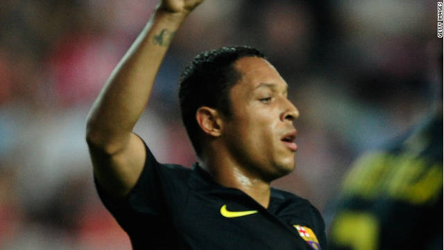 Adriano celebrates the only goal of the match for Barcelona at Sporting Gijon
