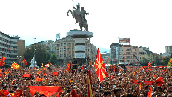 Crowds celebrate the European success of the Macedonian national basketball team in front of the new Warrior on a Horse statue in Skopje