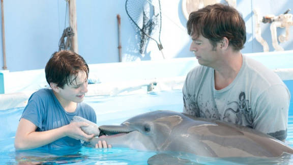 """""""Dolphin Tale"""" is playing very well to families and it should continue to enjoy small drops."""