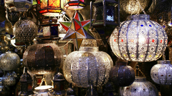 Morocco's business environment has been on an upward spiral recently, and the country has moved up eight places in the annual Doing Business report by the World Bank, from 95th to 87th. Seen here are gilded lanterns on offer in a Marrakesh souk.